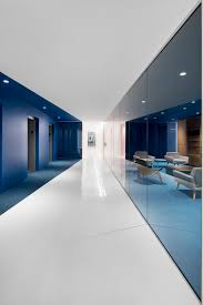 white office interior. The Contemporary And Open-concept Office Design Is Mostly White, But Blocks Of Color Have Been Used To Define Various Areas Throughout Interior. White Interior M