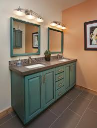eclectic guest bath slate countertop with dual under mounted sinks and iridescent glass tile backsplash