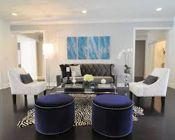 stunning living room animal rug decorating ideas featuring dark blue velvet ottomans and contemporary contrast chairs