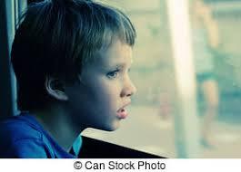 child looking through window. boy looking through the window child c