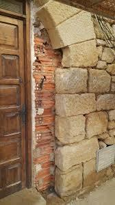 Rehabilitación En Fachada De Piedra Natural  Estecha ReproduccionesFachada De Piedra Natural