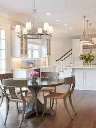 farm style kitchen round top table chairs flowers chandelier pendant lights ceiling lamps stairs hardwood floor