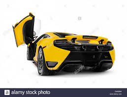 yellow 2018 mclaren 12c supercar with open erfly door rear view isolated sports car on white