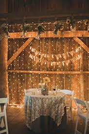 barn wedding lights. Vintage Wedding Idea - Fresh Sunflowers Paired With Twinkle Light Barn Lights