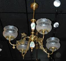 a four arm brass victorian gas chandelier with a satsuma porcelain column in the