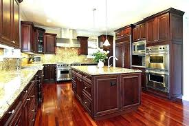 cherry cabinets with granite countertops dark cherry cabinets kitchen in luxury home with wood cabinetry granite cherry cabinets black granite backsplash