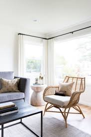 A natural living room design with subtle coastal elements | Venice Rattan  Chair via Serena &
