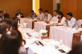 picture attendees sharing their point of views at the cmo roundtable