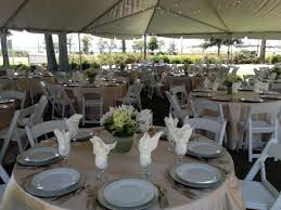 barkley house garden wedding champagne overlays white garden chairs silver chargers