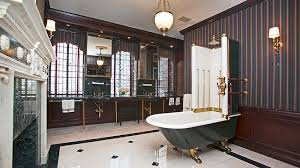 traditional master bathroom with antique clawfoot tub with shower enclosure