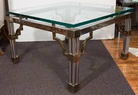 asian inspired glass top chrome coffee table with brass detail asian inspired coffee table