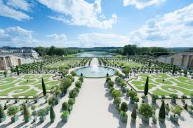 formal gardens and fountains at versailles france