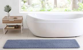 blue memory foam bath rug in a bathroom