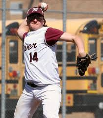 Rocky River pitcher Tyler Louis fields a ground ball and throws to first  for the out against North Ridgeville on Saturday April 27.jpg | |  morningjournal.com