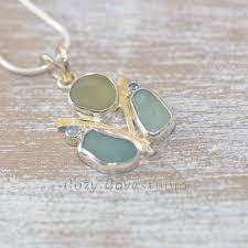 sea glass statement pendant necklace in a tarnish resistant sterling silver setting accented with 22 karat gold n506