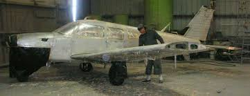 the aircraft is stripped with a water soluble chemical stripper which is sprayed onto the appropriate surfaces
