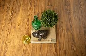 golden waterproof vinyl flooring with plant vases and figurine
