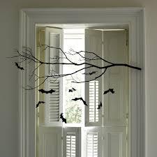 love halloween window decor:  bat mobile  md sq