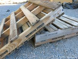 two wooden pallets laying on each other on the ground