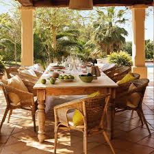 spanish style patio furniture. stone patio with wooden table and wicker chairs spanish style furniture n