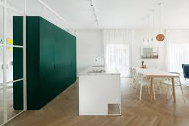Colourful cabinetry for a white Bauhaus-era apartment