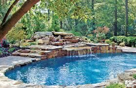 In ground pools with waterfalls Custom Rockwaterfallingroundpool290bhps Olympus Digital Camera Allstate Pools Rock Waterfall Pool Photos Blue Haven Pools