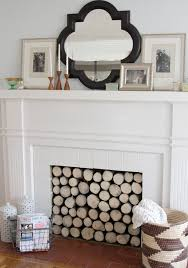 make a faux log insert to hide an ugly fireplace interior