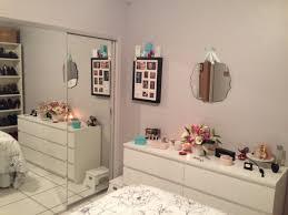 Ikea Malm Dresser. Target wall mirror, photo jewelry box, billy book cases.