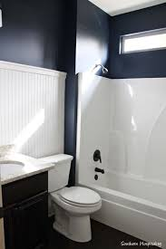 navy bathroom decorating ideas dark walls and white beadboard accent feature wall southern hospitality