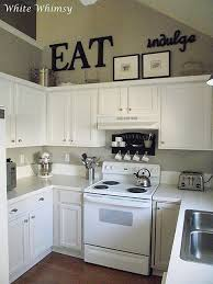 Beautiful Black Accents, White Cabinets! Really Liking These Small Kitchens!