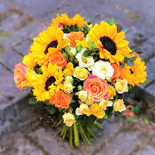 Bright <b>yellow flower bouquet of sunflowers</b>, roses and lisianthus