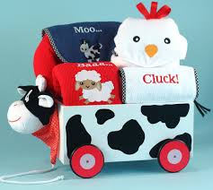 newborn baby gift set featuring cow wagon pull toy baby blanket hooded towel other layette items