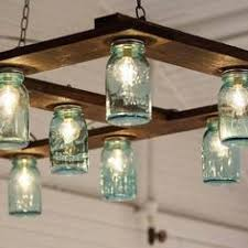 jar lighting fixtures. the couple created their own impressive diy light fixture out of mason jars cafe lights and a wood palette amazing love this jar lighting fixtures