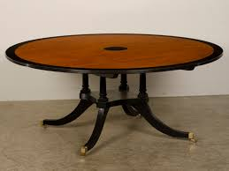 Furniture. brown sheraton style round dining table top with black unusual  tropical timber base on