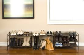 two black iron metal shoe mudroom fit with wooden floor and soft cream wall