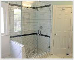 frameless glass shower with white walls and a window to the left