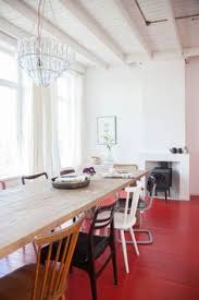 a dutch guest house with red floors and vine touches fine diningdining areadining chairskitchen