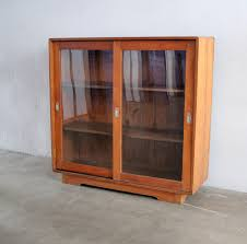 a vintage glass cabinet sliding doors great for books