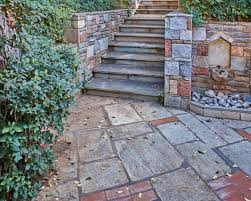 this is another great stairwell with a surrounding retaining wall the ornate design in the side of the wall leading up to the stairs almost looks like a