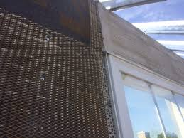 metal lath installation. shown is a close-up view of driwall rainscreen, casing bead along window metal lath installation o