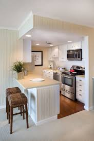 small kitchen cabinets. Modern Small Kitchen Design Featuring White Wooden Cabinets Solid Wood With Brushed Cup Pulls Handle And