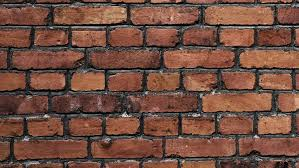 old and torn surface of brick wall traveling left to right animated still picture