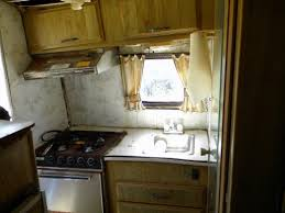the stove and sink area is in pretty bad shape they and the cabinet will