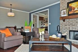 blue gray accent wall in living room blue accent wall transitional living room birmingham by signature