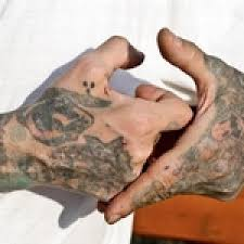 тату символы на руке кинозавр