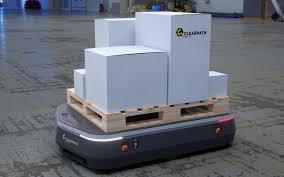 OTTO Self-Driving Vehicle carrying boxes through plant.
