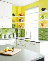 ... White kitchen cabinets and walls in yellow and green colors