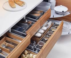 kitchen cabinets designs. kitchen:kitchen cabinets design with multi function racs knife storage spoon and cooking ingridiens kitchen designs i
