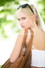 Playing blonde teen outdoor