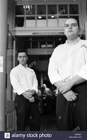 two male doormen bouncers outside pub black and white monochrome entrance portrait portraits doormen doorman bouncer